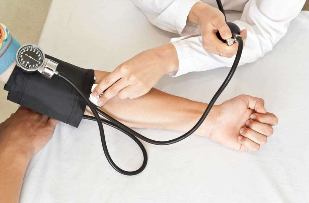 doctor conducting work physical exam new york urgent care